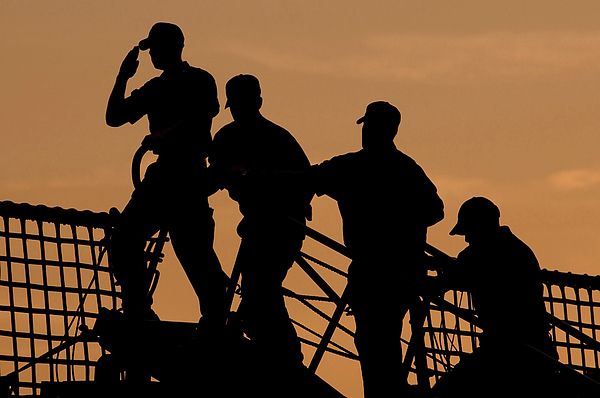 Color Image Photograph - Crewmen Salute The American Flag by Stocktrek Images