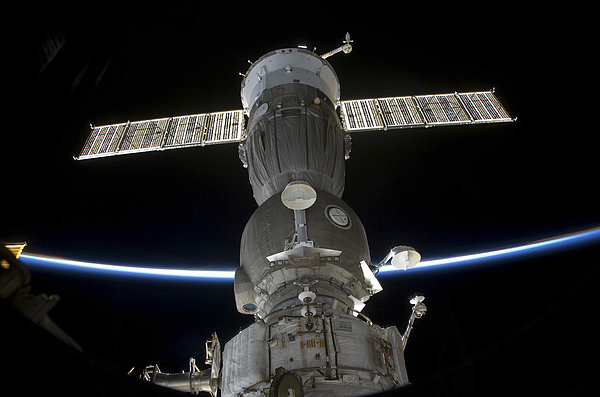 Space Photograph - Earths Limb Intersects A Soyuz by Stocktrek Images