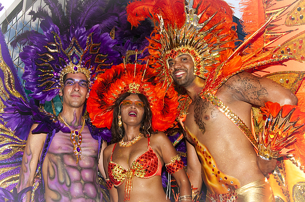 Carnival 2010 Photograph - Faces In The Sun by Francis   Chu Foon