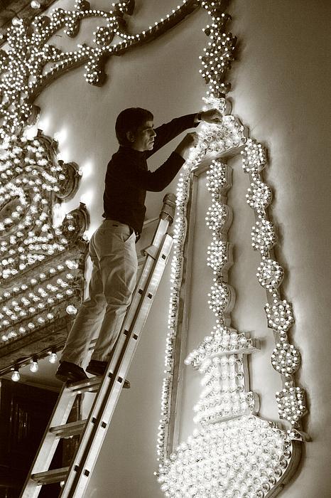 Decorations Photograph - Fixing A Glitch by Gaspar Avila