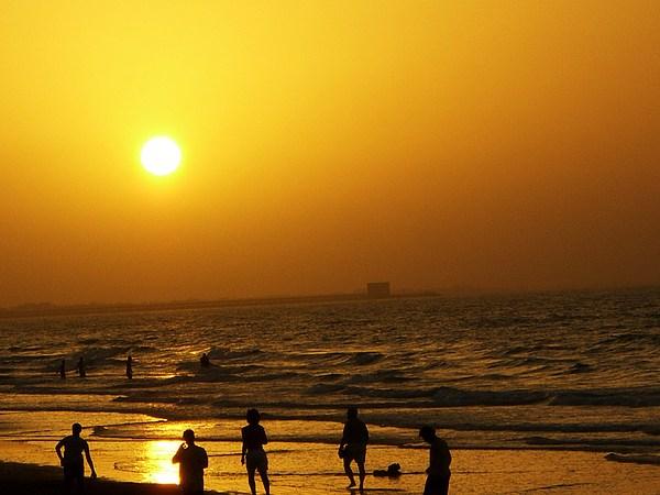 Sunset Photograph - Football And Sunset At The Beach by Sunaina Serna Ahluwalia