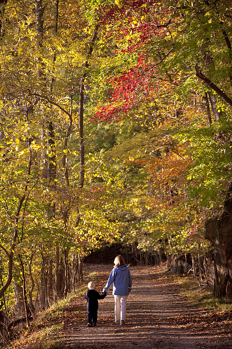 Outdoors Photograph - Four Year Old Boy And His Mom Walk Hand by Skip Brown