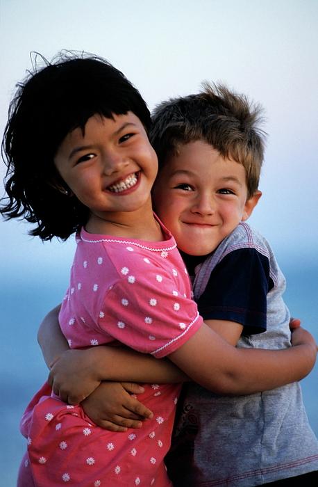 Friendship Photograph - Girl And Boy Embracing by Sami Sarkis
