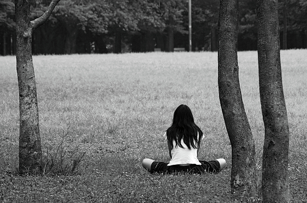 girl sits alone photograph by michael fiorella