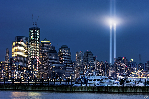 9/11 Photograph - Ground Zero Tribute Lights And The Freedom Tower by Chris Lord