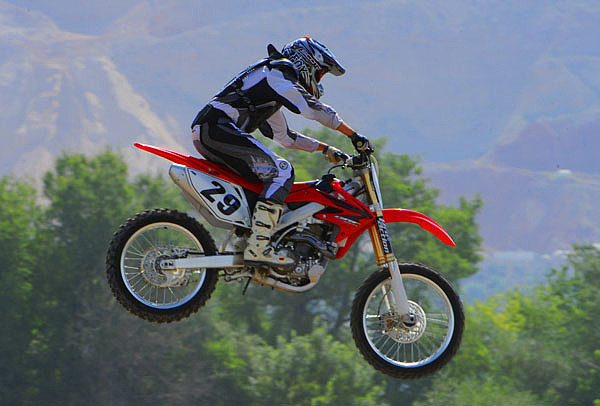 Motorcycle Photograph - High Flyer by Dennis Hammer