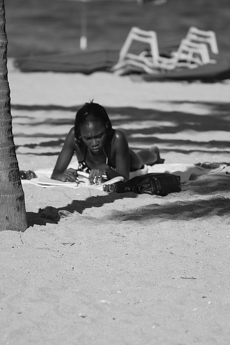 Black And White Photograph - Homework At The Hollywood Beach by Rob Hans
