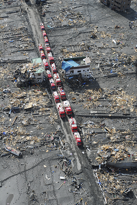 Humanitarian Assistance Photograph - Japanese Fire Trucks Line A Road by Stocktrek Images