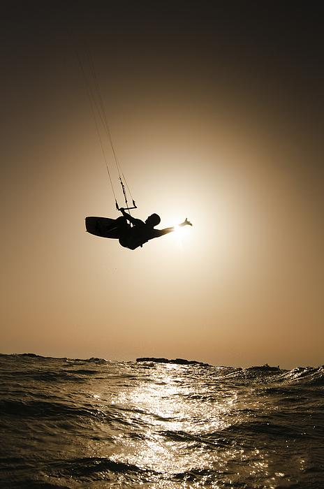 Kitesurfing Photograph - Kitesurfing At Sunset by Hagai Nativ