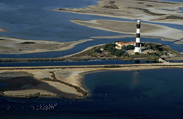 Assistance Photograph - La Gacholle Lighthouse Surrounded With Blue Sea In Camargue by Sami Sarkis