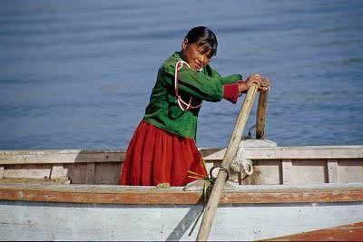 Peru Photograph - Lake Titicaca Commute by Andrew Greene