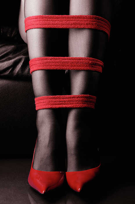 Legs Photograph - Legs In Red Ropes by Oleksiy Maksymenko