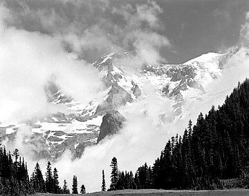 Mountain Landscape Photograph - Lifting Clouds by Paul Schaufler