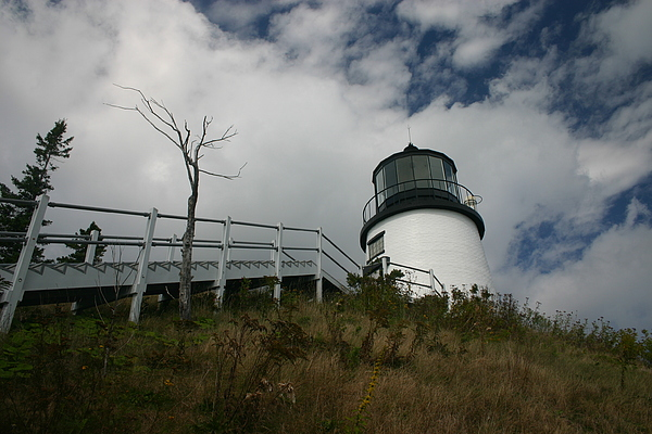 Lighthouse Photograph - Light In The Sky by Dennis Curry