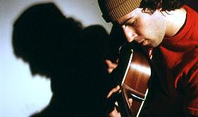 Guitar Photograph - Man And Guitar As One by Tony Zupancic