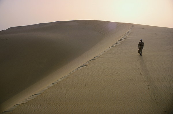 Day Photograph - Murrah Tribesman Walking On A Large by Thomas J Abercrombie