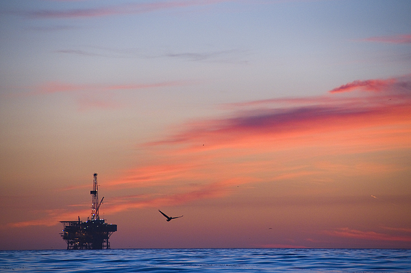 Sunset Photograph - Offshore Oil And Gas Rig In The Pacific by James Forte