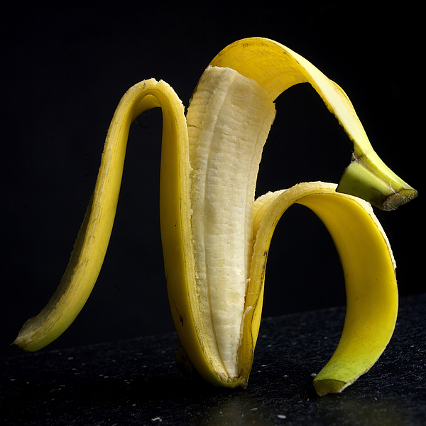 Studio Photograph - Peeled Banana. by Bernard Jaubert