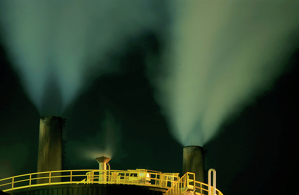Air Pollution Photograph - Petroleum Refinery Chimneys At Night by Sami Sarkis