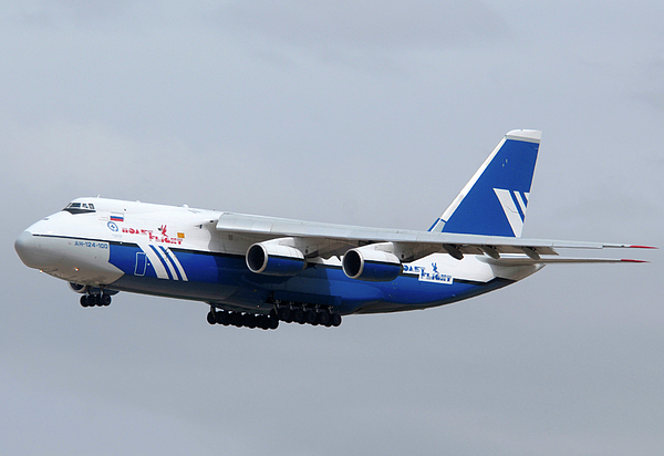 Airplane Photograph - Polet An-124-100 Ruslan Ra-82080 Landing Phoenix-mesa Gateway Airport April 8 2011 by Brian Lockett