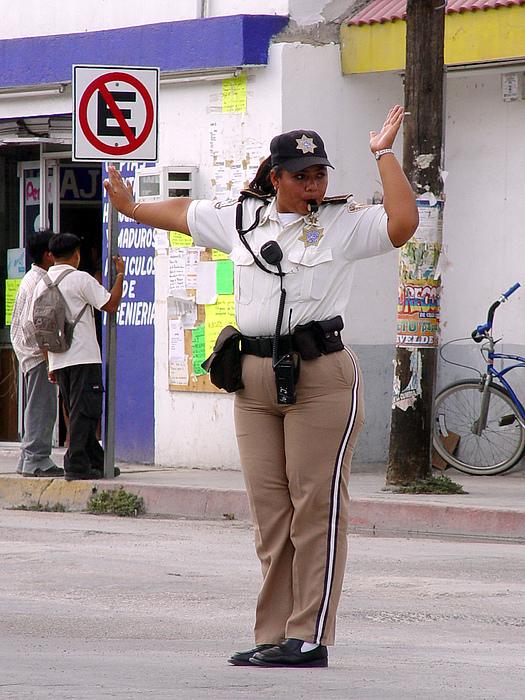 Policia De Transito Photograph by Angel Ortiz