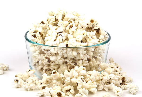 Popcorn Photograph - Popcorn In Glass Bowl by Blink Images