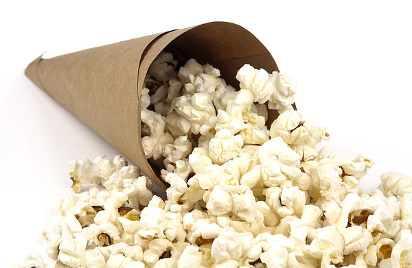 Popcorn Photograph - Popcorn In Paper Cone by Blink Images