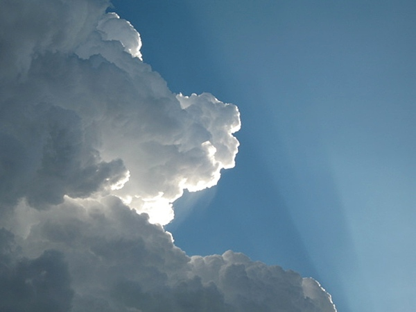 Clouds Photograph - Puffy White Clouds by Liz Vernand