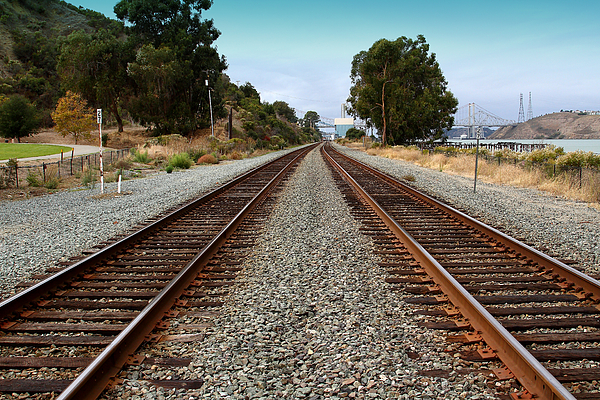 Transportation Photograph - Railroad Tracks With The New Alfred Zampa Memorial Bridge And The Old Carquinez Bridge In Distance by Wingsdomain Art and Photography