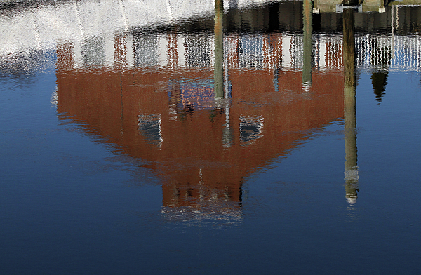 Reflection Photograph - Red Building Reflection by Karol Livote