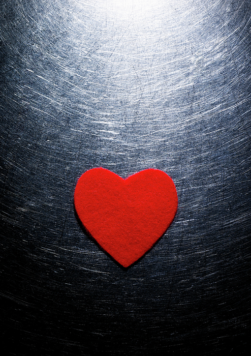 Vertical Photograph - Red Felt Heart On Stainless Steel Background. by Ballyscanlon
