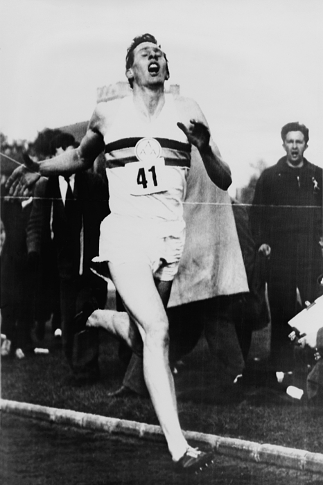 History Photograph - Roger Bannister Crossing The Finish by Everett