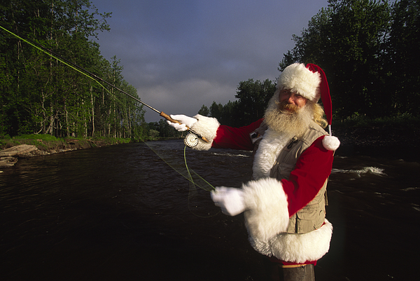 Outdoors Photograph - Santa Claus Fly Fishing by Michael Melford