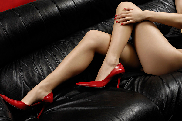 Sexy Long Legs In Red High Heels Photograph by Oleksiy Maksymenko