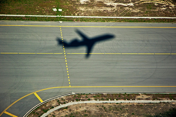 Aeroplane Photograph - Shadow Of An Airplane Taking Off by Sami Sarkis