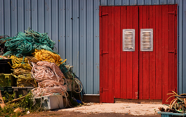 Travel Photograph - Shed Doors And Tangled Nets by Louise Heusinkveld