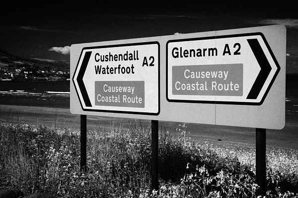Sign Photograph - Signposts For The Causeway Coastal Route At Carnlough Between Cushendall And Glenarm County Antrim by Joe Fox