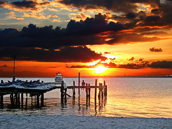 Sunset Photograph - Sitting On The Dock by Larry Roby
