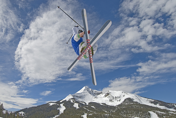 Outdoors Photograph - Skiing Aerial Maneuvers Off A Jump by Gordon Wiltsie
