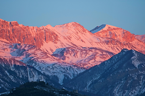 Alpenglow Photograph - Snowy Mountain Range With A Rosy Hue At Sunset by Sami Sarkis