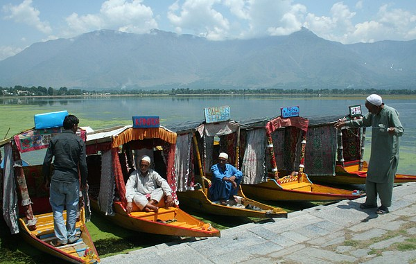 Boatman Photograph - Srinagar by Mohammed Nasir