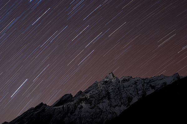 Colour Image Photograph - Star Trails Above Himal Chuli Created by Alex Treadway