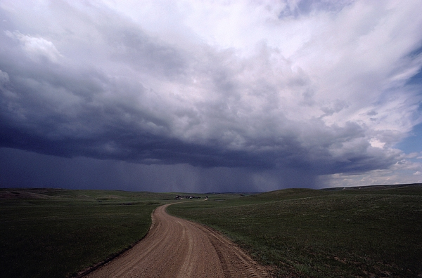 North Dakota Photograph - Storm Clouds Over The North Dakota by Annie Griffiths