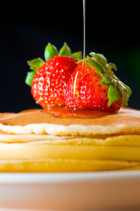 Berries Photograph - Strawberry Butter Pancake With Honey Maple Sirup Flowing Down by U Schade