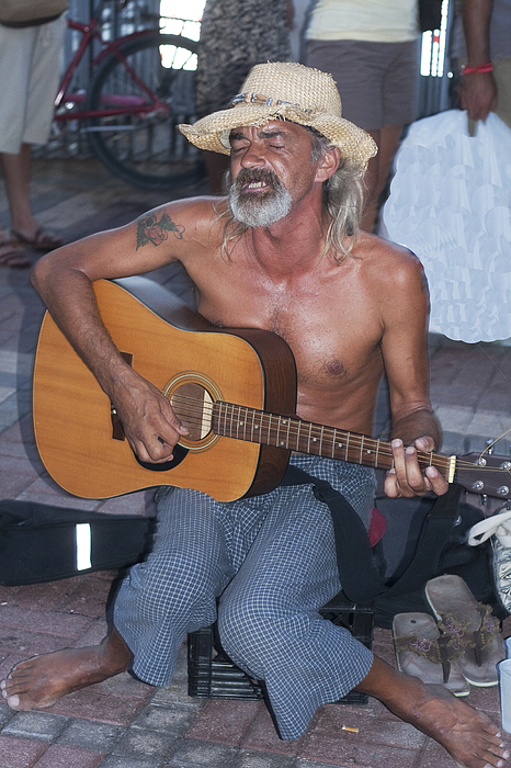 Guitar Photograph - Strumming A Tune In Key West by Carl Purcell