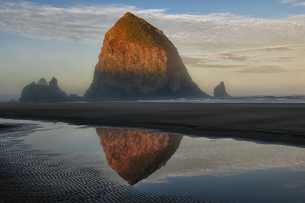 Waterscapes Photograph - Sunrise On Haystack Rock - Oregon by Sandra Bronstein