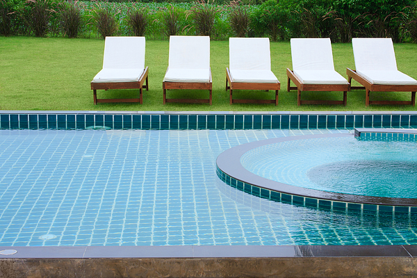 Activity Photograph - Swimming Pool And Chairs by Atiketta Sangasaeng