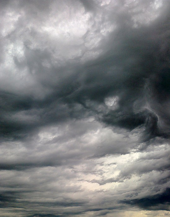 Clouds Photograph - Swirling Clouds by Stephen Doughten