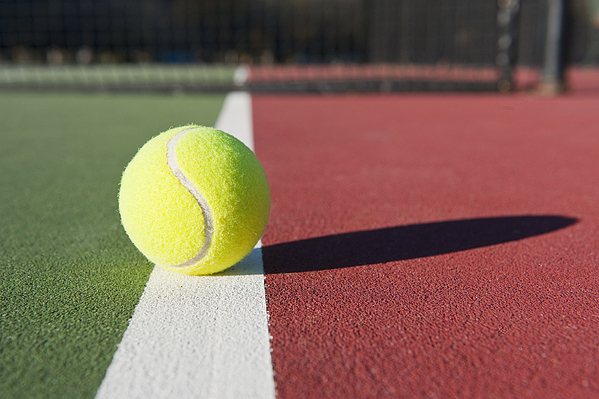 Ball Photograph - Tennis Ball Sitting On Court by Thom Gourley/Flatbread Images, LLC