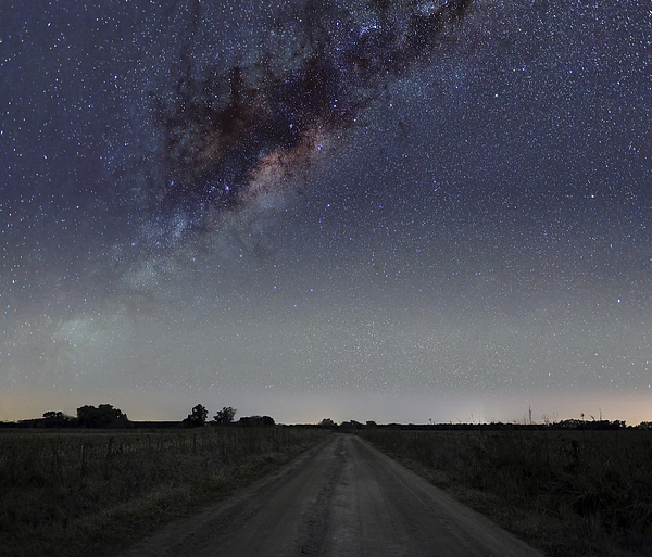 Road Photograph - The Milky Way Galaxy Over A Rural Road by Luis Argerich